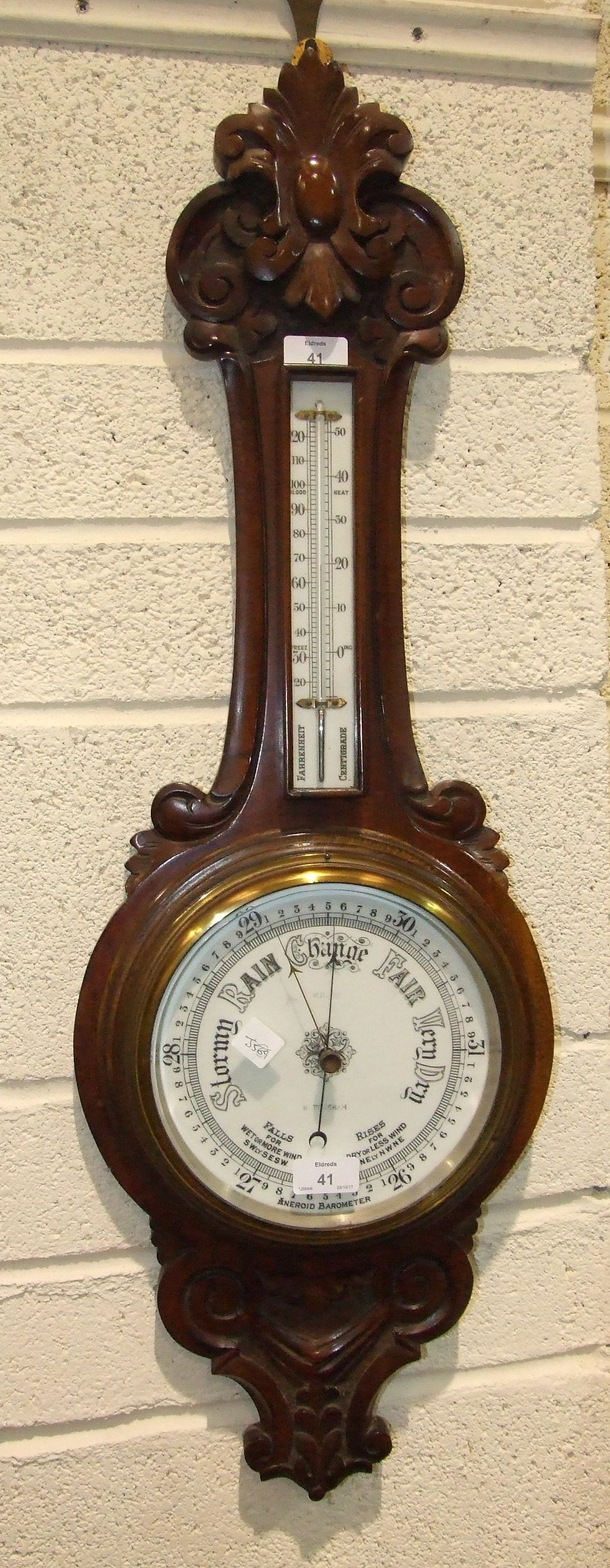 Lot 41 - W H May, Nottingham, a carved stained mahogany banjo aneroid barometer/thermometer, 90cm high.