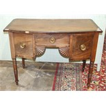 A Georgian small mahogany sideboard, the slightly-bowed top above a central drawer, flanked by a