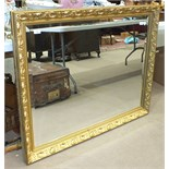 A large modern gilt-framed bevelled wall mirror, plate 75 x 100cm, 90 x 115cm overall.