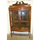 An Edwardian inlaid mahogany display cabinet, the rectangular top with swan neck back, above a