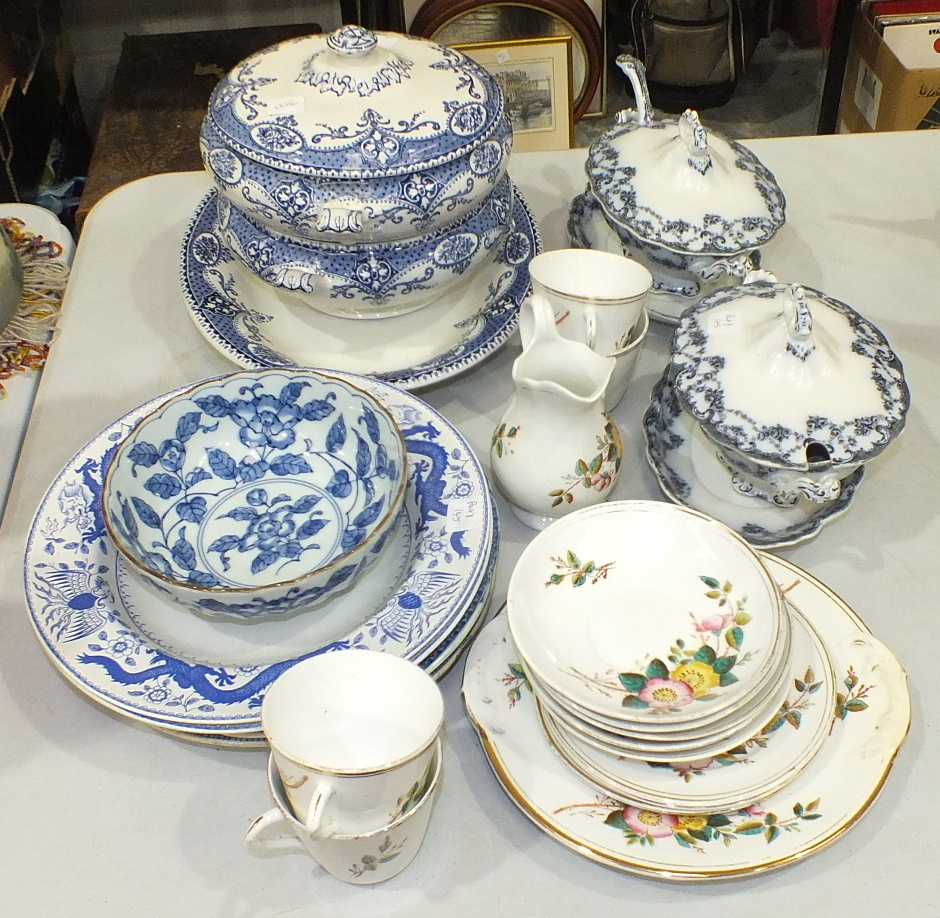 Lot 145 - Fourteen pieces of late-19th century teaware decorated with flowers, a collection of various blue