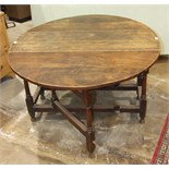An antique oak gate-leg drop-leaf table with fitted end drawer, on turned legs, 146.5 x 120cm.