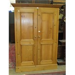 A modern pine two-door wardrobe, 131cm wide, 184cm high.