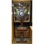 A Late-Victorian stained mahogany four-branch hall stand with central circular mirror, glove box and