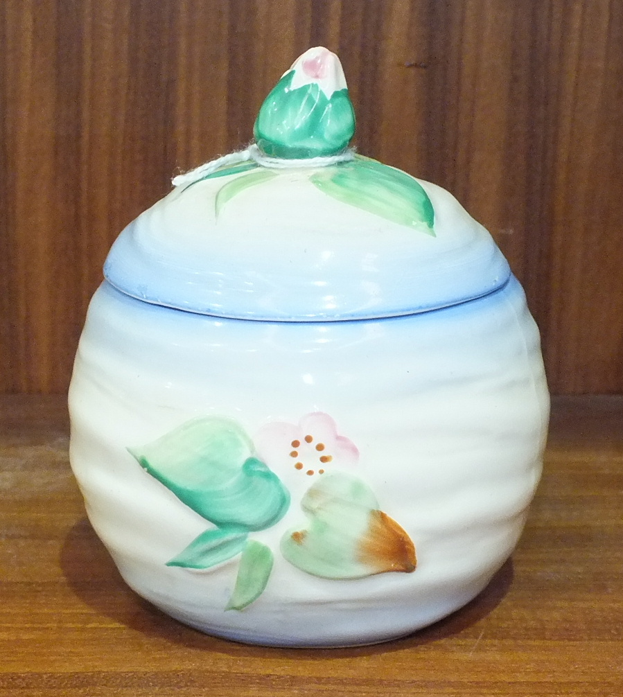 Lot 122 - A Clarice Cliff preserve pot and cover with pink water lily finial, facsimile signature, 'Newport