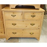 A stripped pine straight-front chest of two short and two long drawers, 90cm wide, 82cm high.