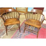 A pair of stained wood 'Captain's' armchairs with turned slats and wood seats, on turned legs, (2).