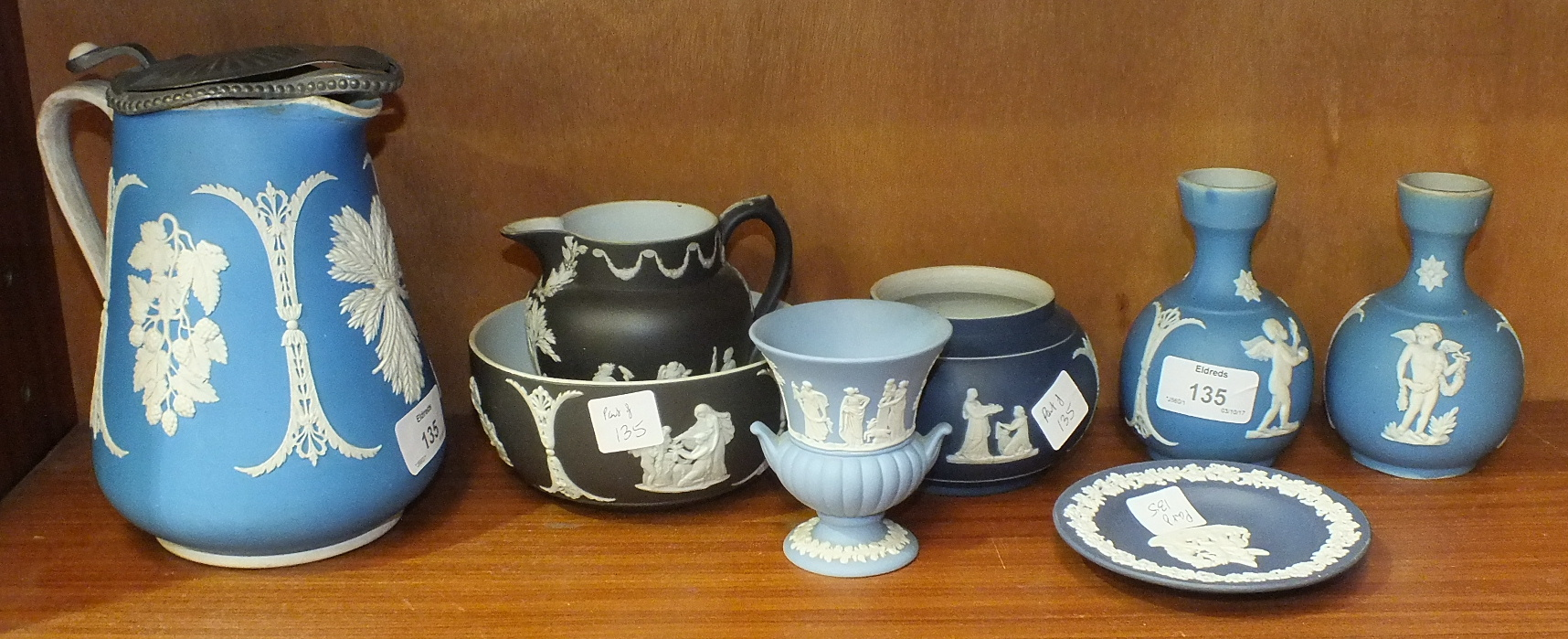 Lot 135 - An unmarked blue and white jasperware pewter-lidded jug decorated with berries, leaves and corn,