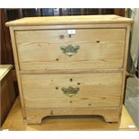 A low stripped pine chest of two drawers, 67.5cm wide, 68cm high.
