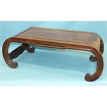 An Oriental hardwood rectangular opium table on scroll supports, 89 x 43cm.