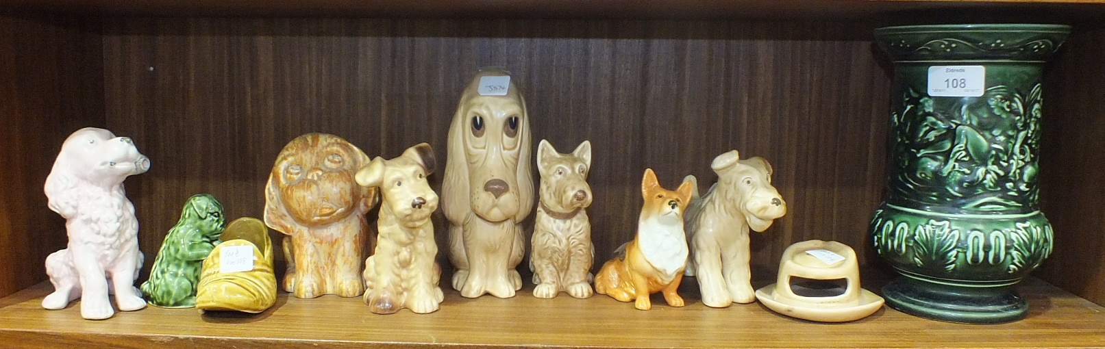Lot 108 - A collection of seven SylvaC dog ornaments, including no.3275 seated dog with pipe, (pink-glazed), a