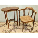 An Edwardian inlaid wood corner armchair with pierced slats and padded seat, on turned legs and an