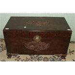 A mid-20th century camphor wood chest with carved decoration to top and front, 85cm wide, (a/f).