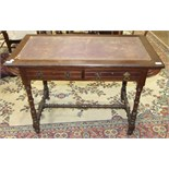 An Edwardian stained hardwood writing table, the rectangular top with leather inset above two