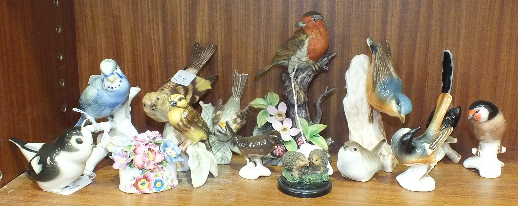 Lot 120 - A collection of twelve Goebel and Lomonosov porcelain bird ornaments, (12).