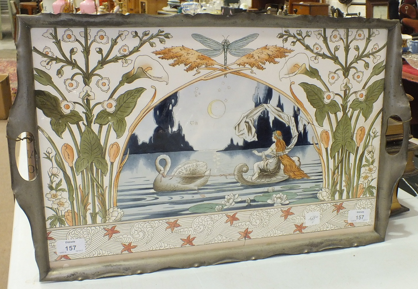 Lot 157 - An Art Nouveau Continental rectangular pottery plaque, the central decoration of a swan towing a