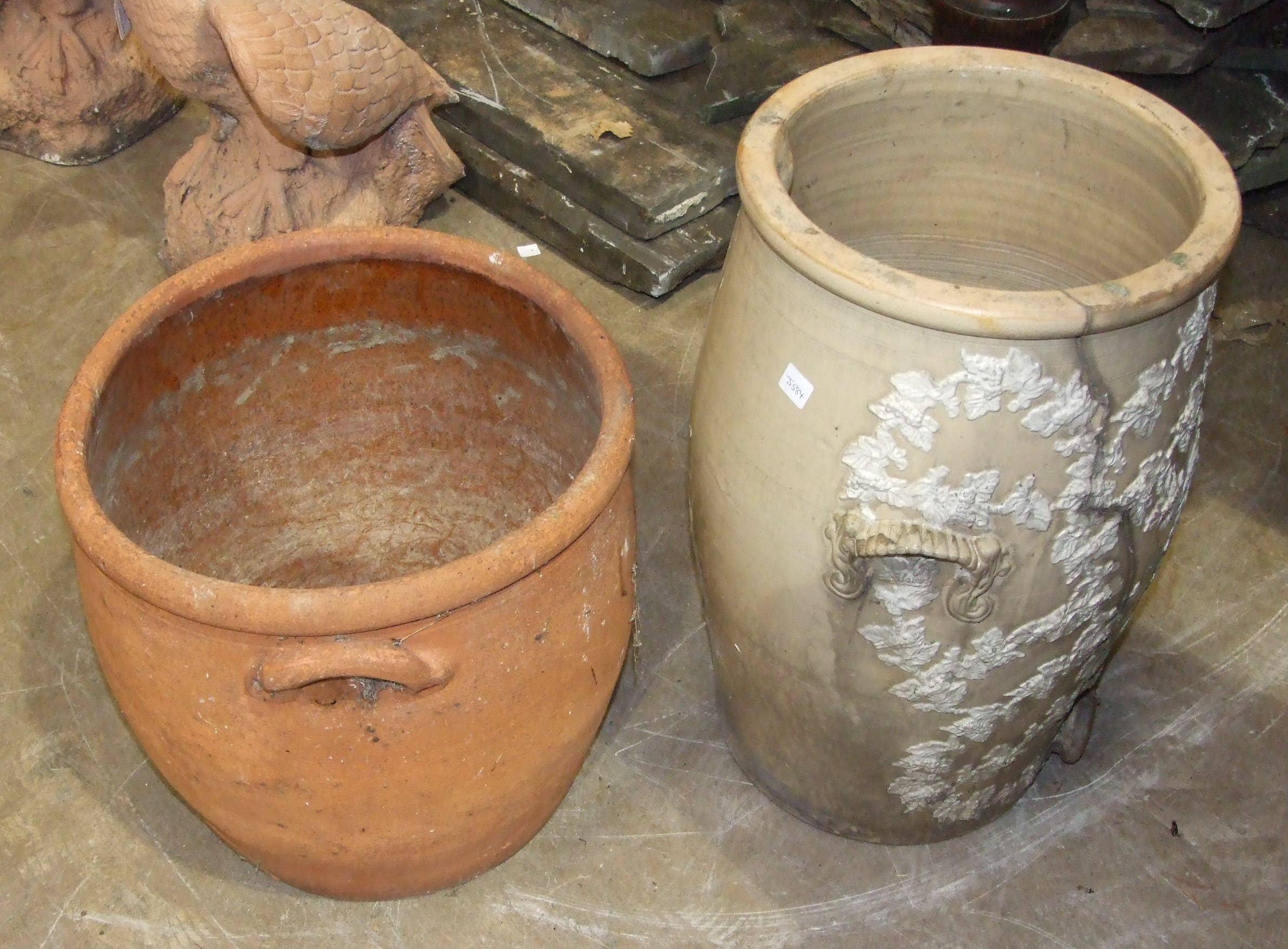 Lot 73 - A Lipscombe & Co. stone glazed water filter, incomplete, 55cm high and an earthenware garden pot,