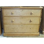 A stripped pine straight-front chest of three drawers on plinth base, 106cm wide, 85cm high.