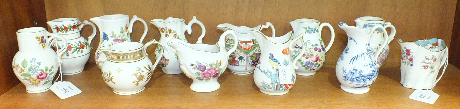 Lot 168 - Twelve Royal Worcester porcelain jugs from the 'Historic Jugs' collection, tallest 9.5cm, (12).