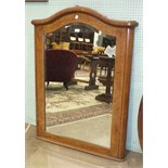 A 19th century French burr walnut cross-banded pier mirror, the arched corniced frame enclosing a