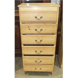 A pine narrow chest of six drawers, 58cm wide, 124cm high.