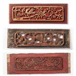 THREE CARVED WOODEN PANELS IN RED AND GOLD Wood and gold. China, 19th cent.Nicely crafted wood