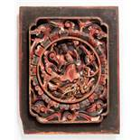 A VERY NICE WOODEN PANEL WITH A DEITY ON A DRAGON Wood with old painting. China, 19th cent.A carving