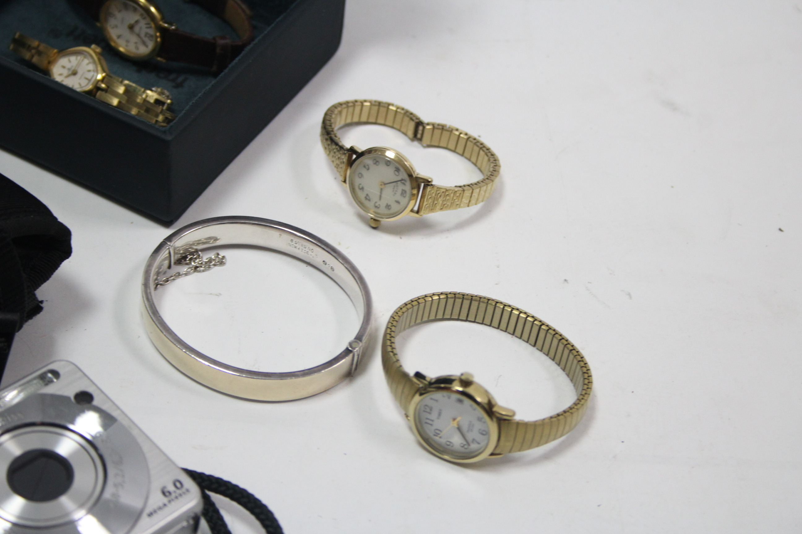Lot 126 - A Tom-Tom SatNav; two modern cameras; four ladies' wristwatches; & a plated hinged bracelet, etc.