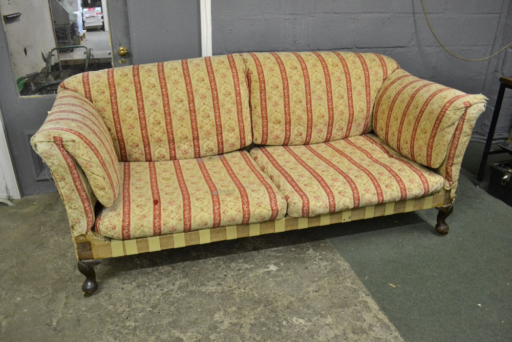 Lot 2887 - Howard and Sons ' The Fielding ' two seat sofa circa 1910 with fitted cushions to back and side and