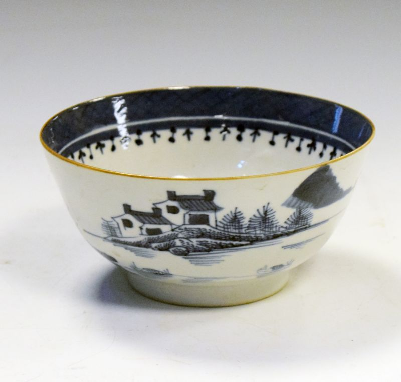 18th Century blue and white porcelain bowl decorated in underglazed blue with lakeside pavilions,