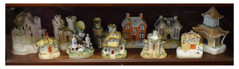 Collection of mainly 19th Century Staffordshire pottery cottages, pastille burners, moneybox etc