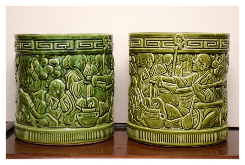Pair of Bretby cylindrical green glazed jardinières depicting chinoiserie scenes, the bases with