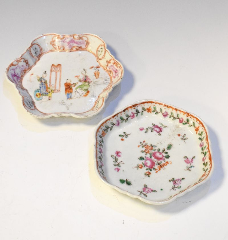 Two late 18th Century porcelain teapot stands of hexagonal design, one decorated in the Famille Rose