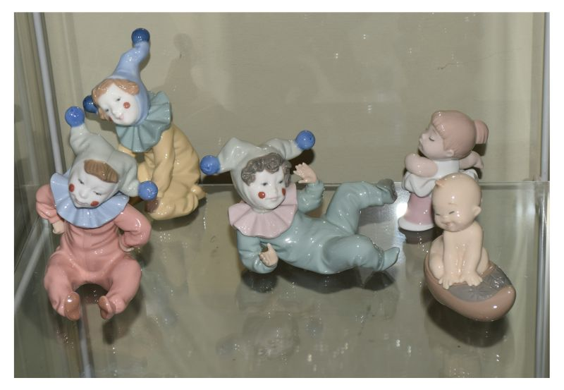 Five various Spanish Nao porcelain figurines modelled as clown children (3) and babies (2),