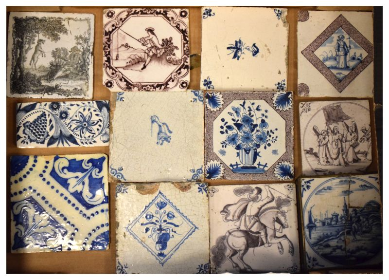 Group of 18th Century Delftware and other pottery tiles to include; seven manganese examples,