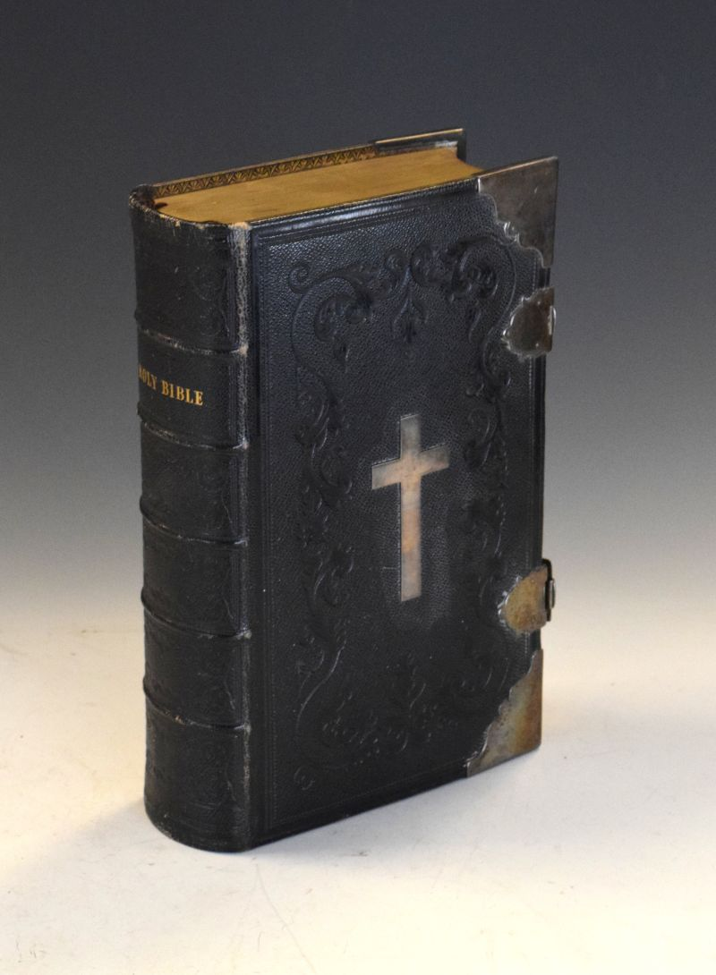 Lot 282 - 19th Century leather bound Bible having crucifix mount to front