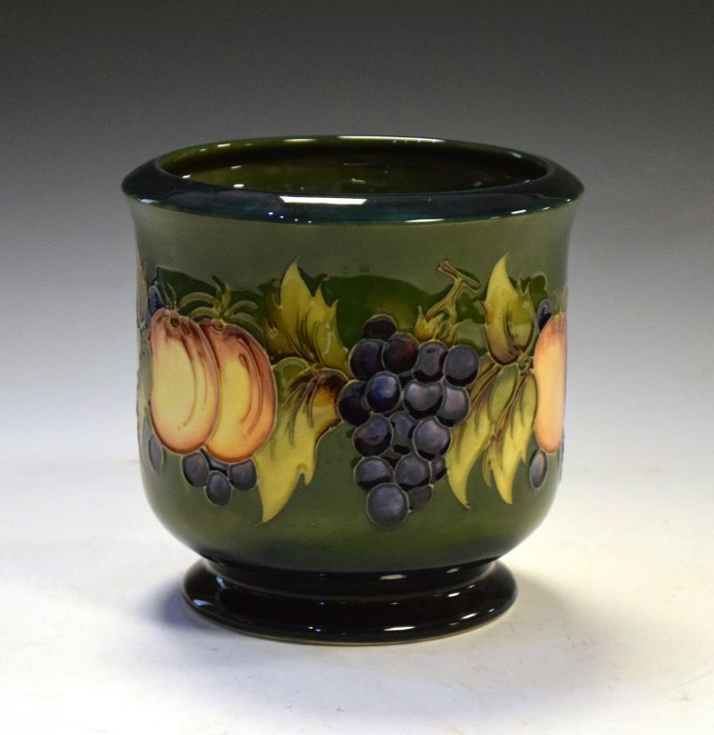 Moorcroft pottery Fruit pattern jardinière tube lined with grapes and peaches on a shaded green