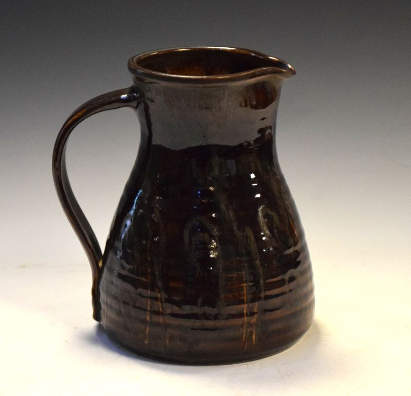 Margaret Leach - Mid 20th Century studio pottery jug of ribbed bulbous form with brown treacle