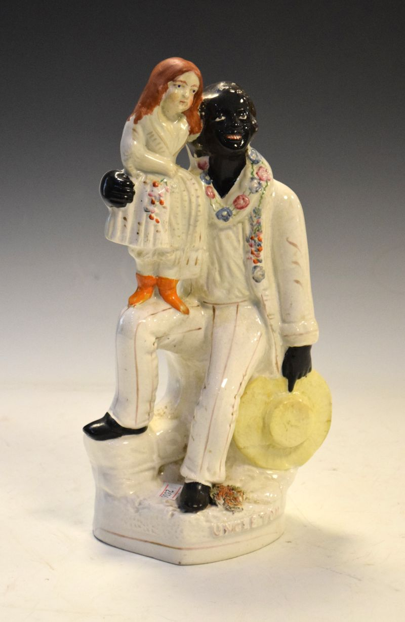 Victorian Staffordshire pottery figure group of Uncle Tom and Eva, 27.5cm high