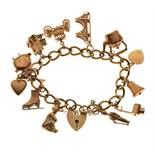 9ct gold curb-link charm bracelet with heart-shaped padlock and twelve assorted gold and yellow