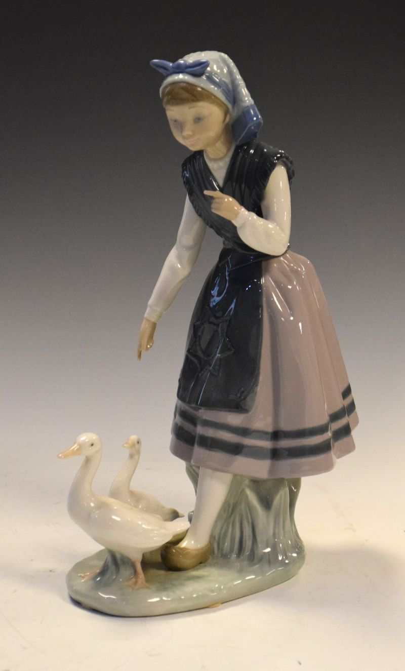 Lladro Spanish porcelain figurine of a young girl with two ducks, 26.5cm high