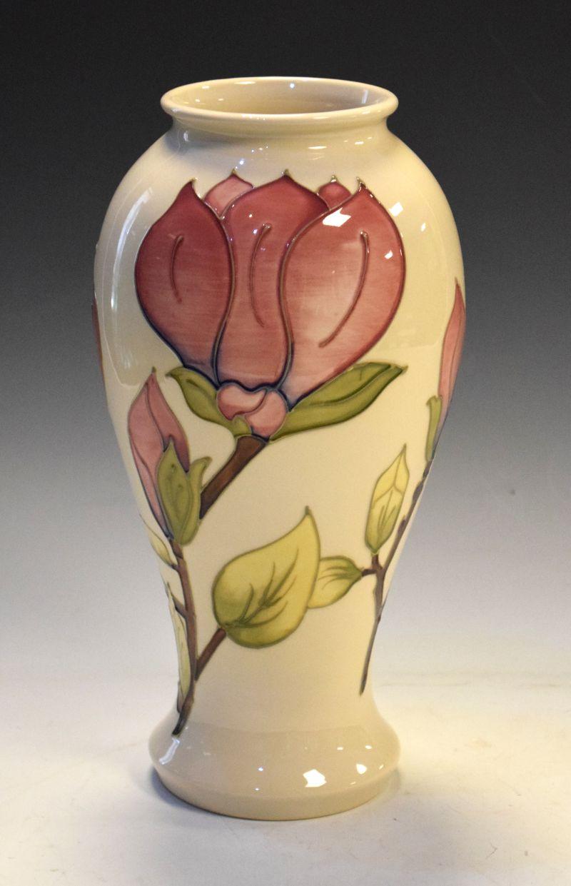 Walter Moorcroft pottery Magnolia pattern vase of baluster form, 30.5cm high