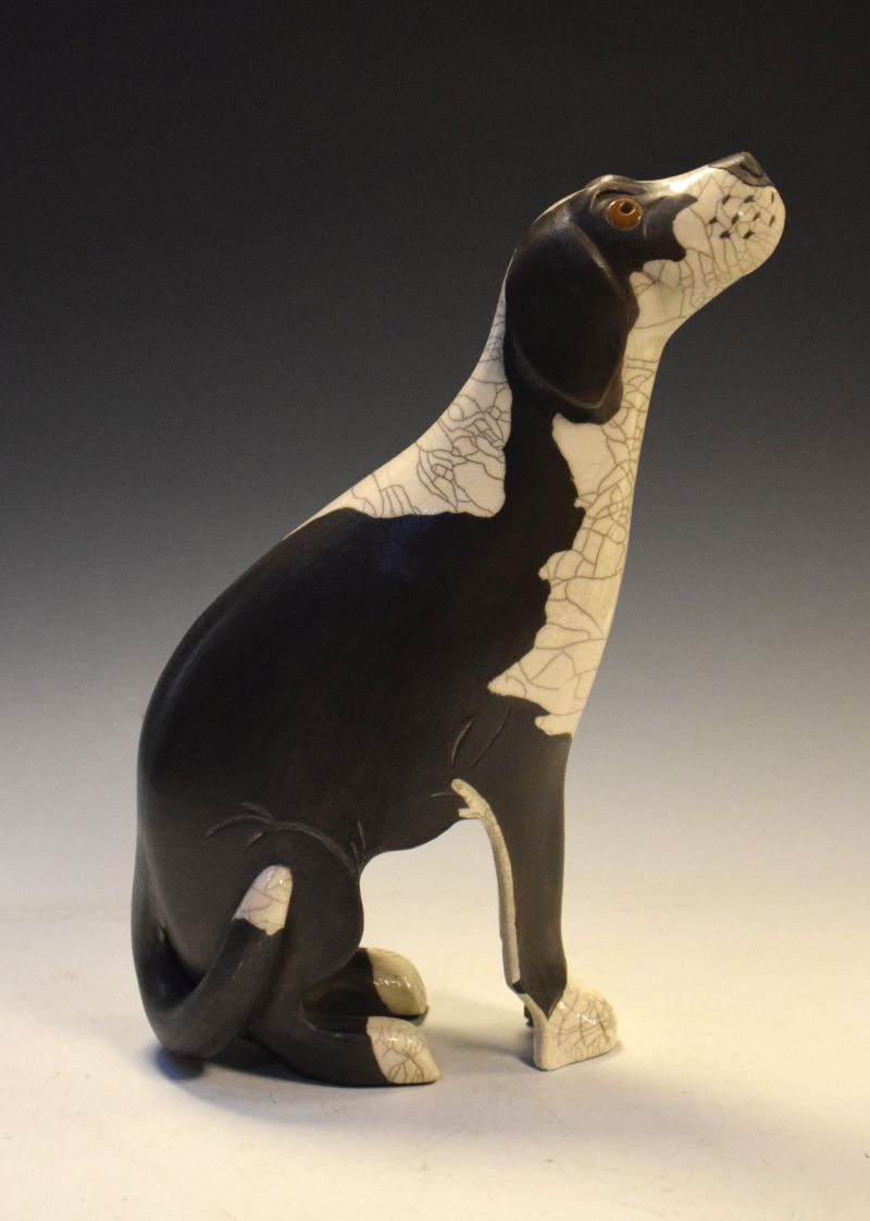 Studio Pottery figure of a black and white dog, impressed mark to base TW, 40cm high