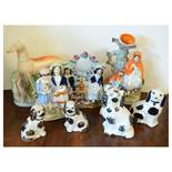 Quantity of Staffordshire pottery figures, spill vase, greyhound etc