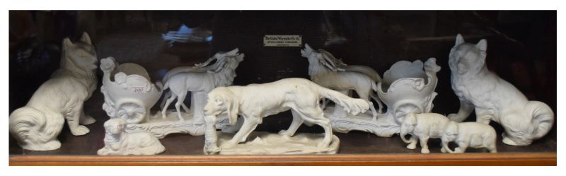 Quantity of bisque porcelain animal figures including stags pulling chariot