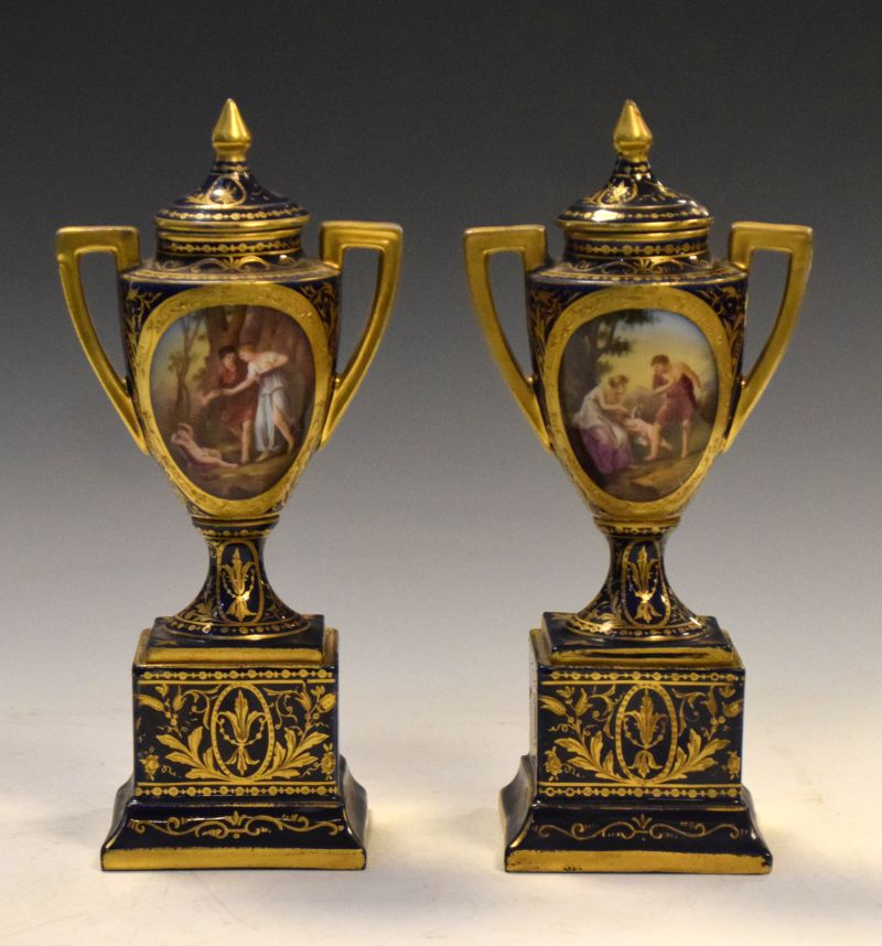 Pair of early 20th Century Austrian (Vienna) porcelain urns and pedestals, decorated with entitled
