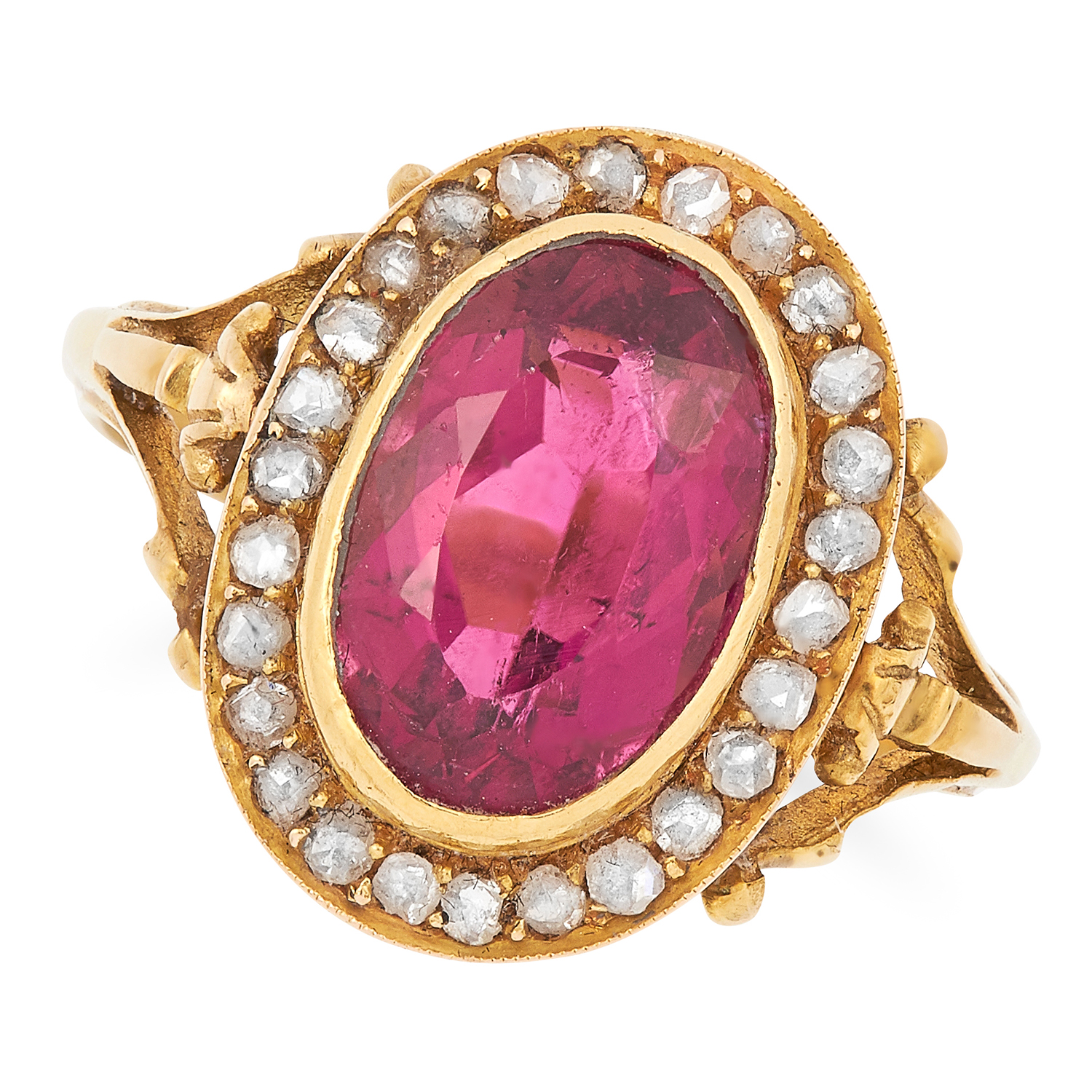 ANTIQUE TOURMALINE AND DIAMOND CLUSTER RING set with an oval cut tourmaline in a border of rose