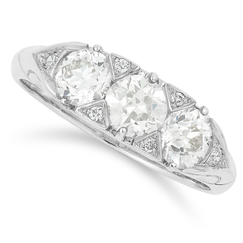1.29 CARAT THREE STONE RING set with three round cut diamonds, size M / 6, 4.4g.