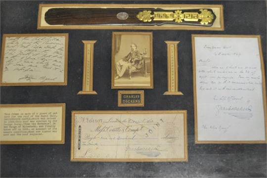 A framed and glazed collection of Charles Dickens memorabilia ...