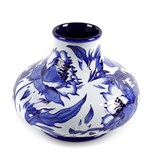 A modern Moorcroft pottery vase. Of squat form, decorated to the whole with Florian-style flowers of